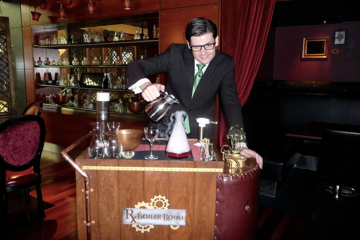 Eric Smith conjures up a concoction on the Rx Boiler Room cocktail cart.