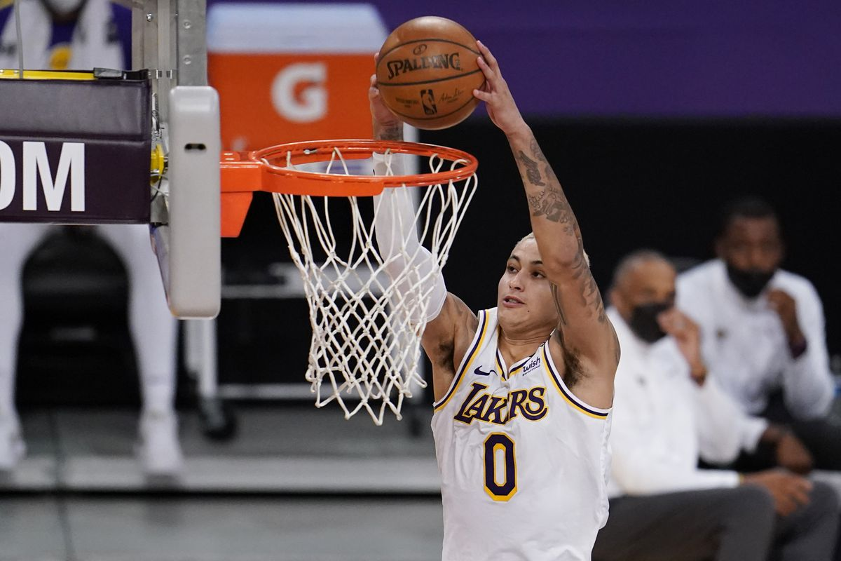 Los Angeles Lakers forward Kyle Kuzma scores on a breakaway dunk against the Orlando Magic