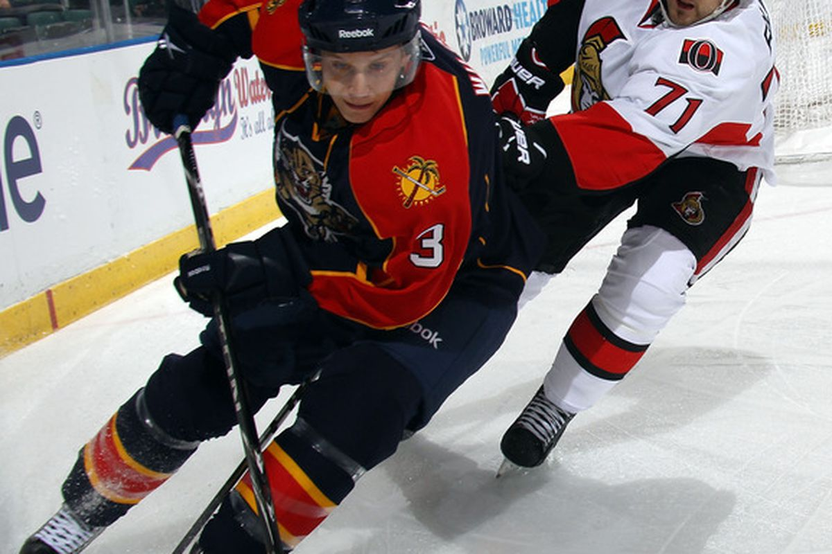 SUNRISE, FL - MARCH 10: Clay Wilson #3 of the Florida Panthers carries the puck around Nick Foligno #71 of the Ottawa Senators at the BankAtlantic Center on March 10, 2011 in Sunrise, Florida.  (Photo by Bruce Bennett/Getty Images)