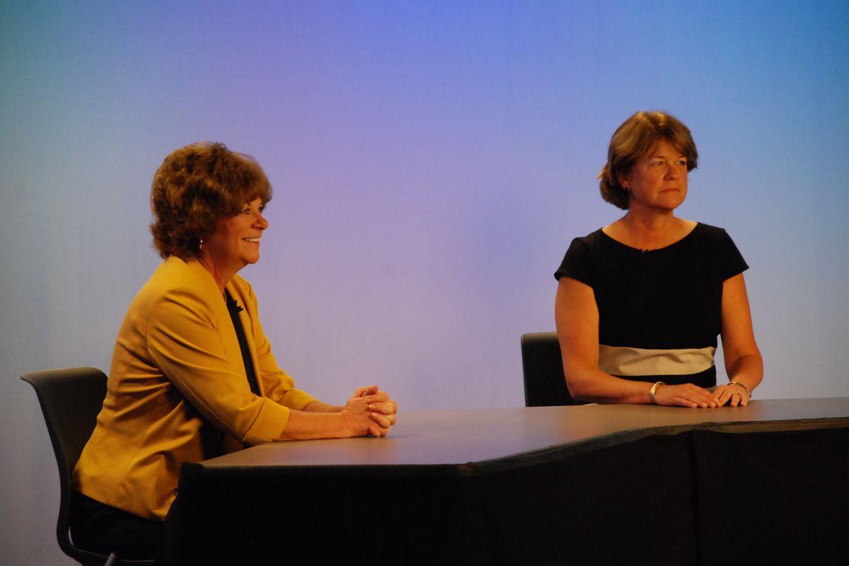Denver school board candidate Kristi Butkovich and incumbent Anne Rowe wait for a televised debate to begin.