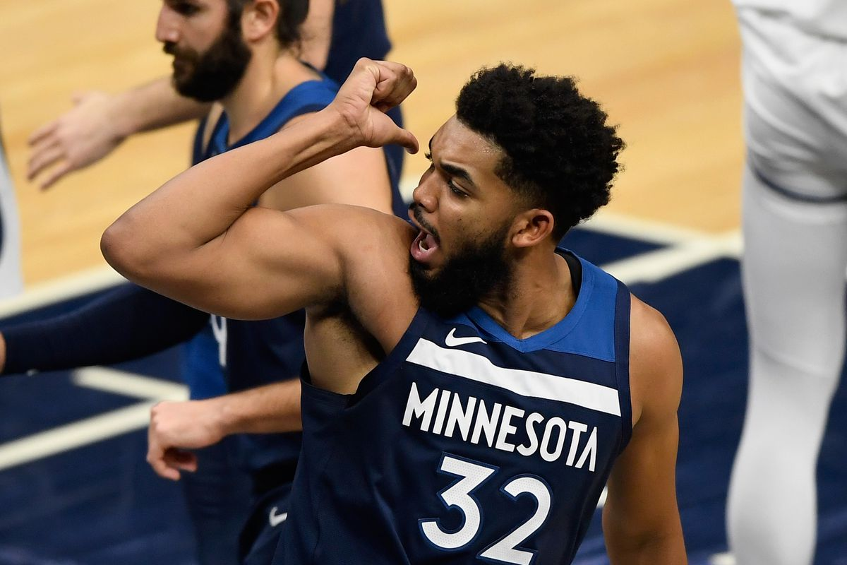 Karl-Anthony Towns of the Minnesota Timberwolves reacts during the fourth quarter of the game against the Minnesota Timberwolves at Target Center on January 13, 2021 in Minneapolis, Minnesota. The Grizzlies defeated the Timberwolves 118-107.