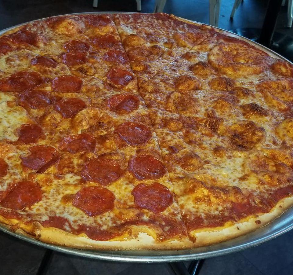A half plain, half pepperoni pie from Fat Boy's Pizza
