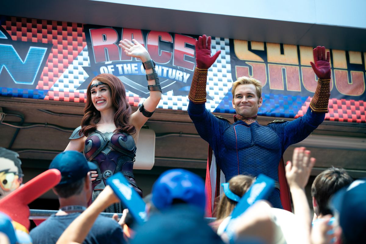 Queen Maeve (Dominique mcelligott) and Homelander Anthony Starr) rally a crowd at the race of the century in The Boys