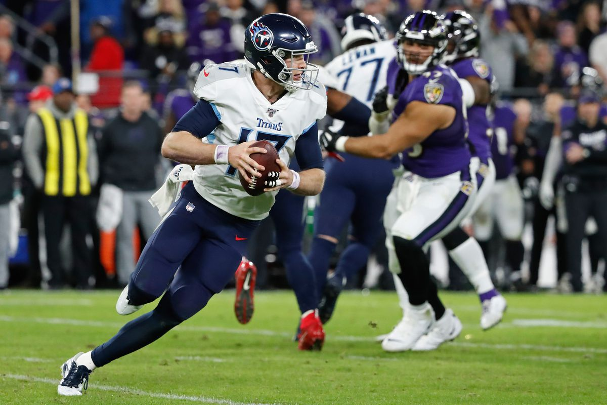 Tennessee Titans quarterback Ryan Tannehill past Baltimore Ravens nose tackle Chris Wormley in a AFC Divisional Round playoff football game at M&T Bank Stadium.