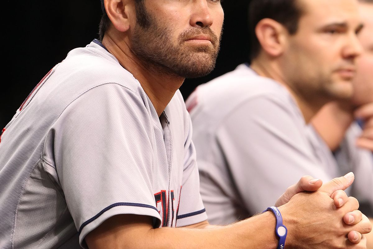 July 19, 2012; St. Petersburg, FL, USA; Cleveland Indians left fielder Johnny Damon (33) in the dugout against the Tampa Bay Rays at Tropicana Field. Mandatory Credit: Kim Klement-US PRESSWIRE