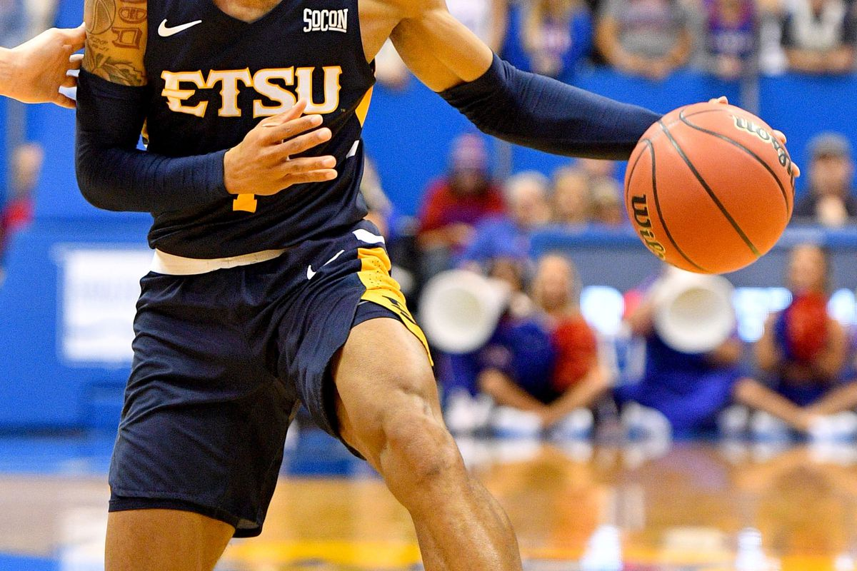 East Tennessee State Buccaneers guard Tray Boyd III dribbles the ball during the game against the Kansas Jayhawks at Allen Fieldhouse.
