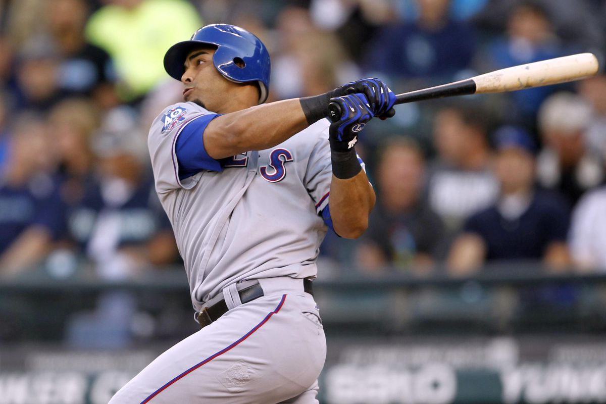 Sept 22, 2012; Seattle, WA, USA; Texas Rangers right fielder Nelson Cruz doubles against the Seattle Mariners during the second inning at Safeco Field. Mandatory Credit: Joe Nicholson-US PRESSWIRE