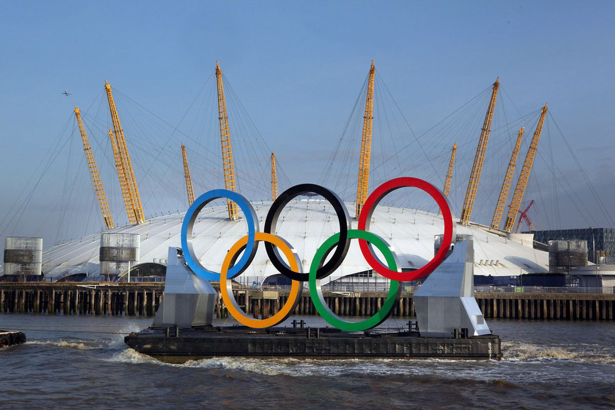 LONDON, ENGLAND - FEBRUARY 28: Giant Olympic rings are towed on The River Thames past the O2 which will be renamed the North Greenwich Arena during the games in London later this year. (Photo by Peter Macdiarmid/Getty Images)