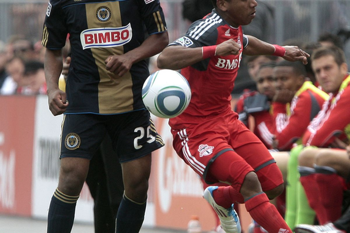TORONTO, CANADA - MAY 28: Joao Plata #7 of Toronto FC heads the ball past Sheanon Williams #25 of Philadelphia Union during MLS action at BMO Field May 28, 2011 in Toronto, Ontario, Canada. (Photo by Abelimages/Getty Images)