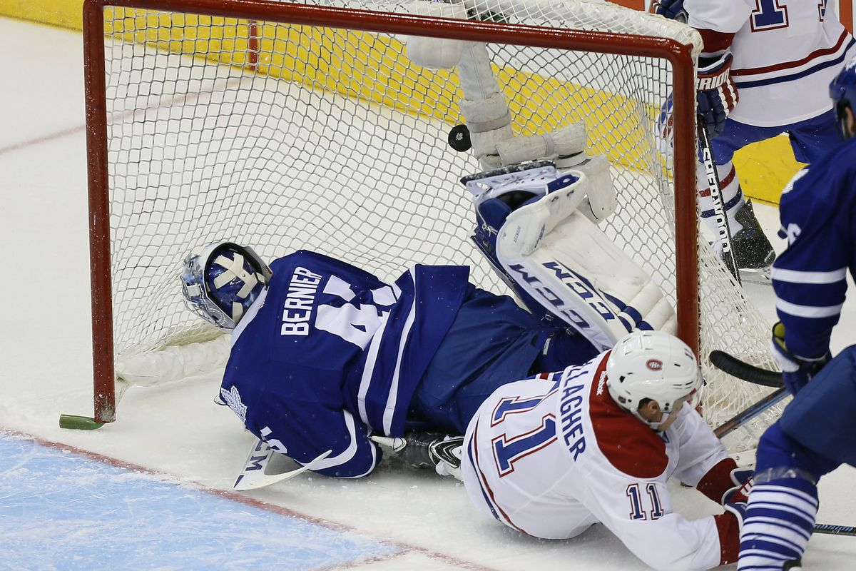 Oct 8, 2014; Toronto, Ontario, CAN; A goal is disallowed after Montreal Canadiens forward Brendan Gallagher (11) crashes into Toronto Maple Leafs goaltender Jonathan Bernier (45) at the Air Canada Centre. Montreal defeated Toronto 4-3. Mandatory Cred