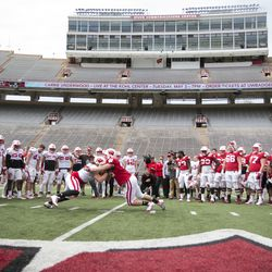 Wisconsin gathers for a blocking drill
