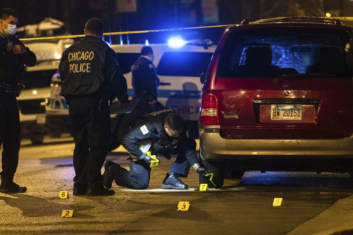 Chicago police investigate the scene where a man was shot and killed and another man wounded in a shooting in the 1300 block of South Homan Ave. in the Lawndale neighborhood, Wednesday, Nov. 11, 2020.