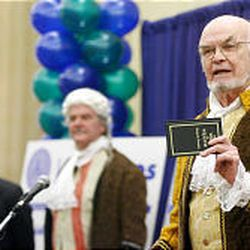 Actors Michael Flynn as Brigham Young, left, Don Glover as George Washington, and Tony Larimer as Benjamin Franklin  discuss the importance of saving money during the statewide launch of Utah Saves in Salt Lake City Wednesday.
