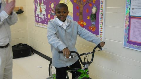 DeVonte' Loyd, a fifth-grader at Side Creek Elementary School in Aurora, tries out the bike he won through 5th Gear Kids.