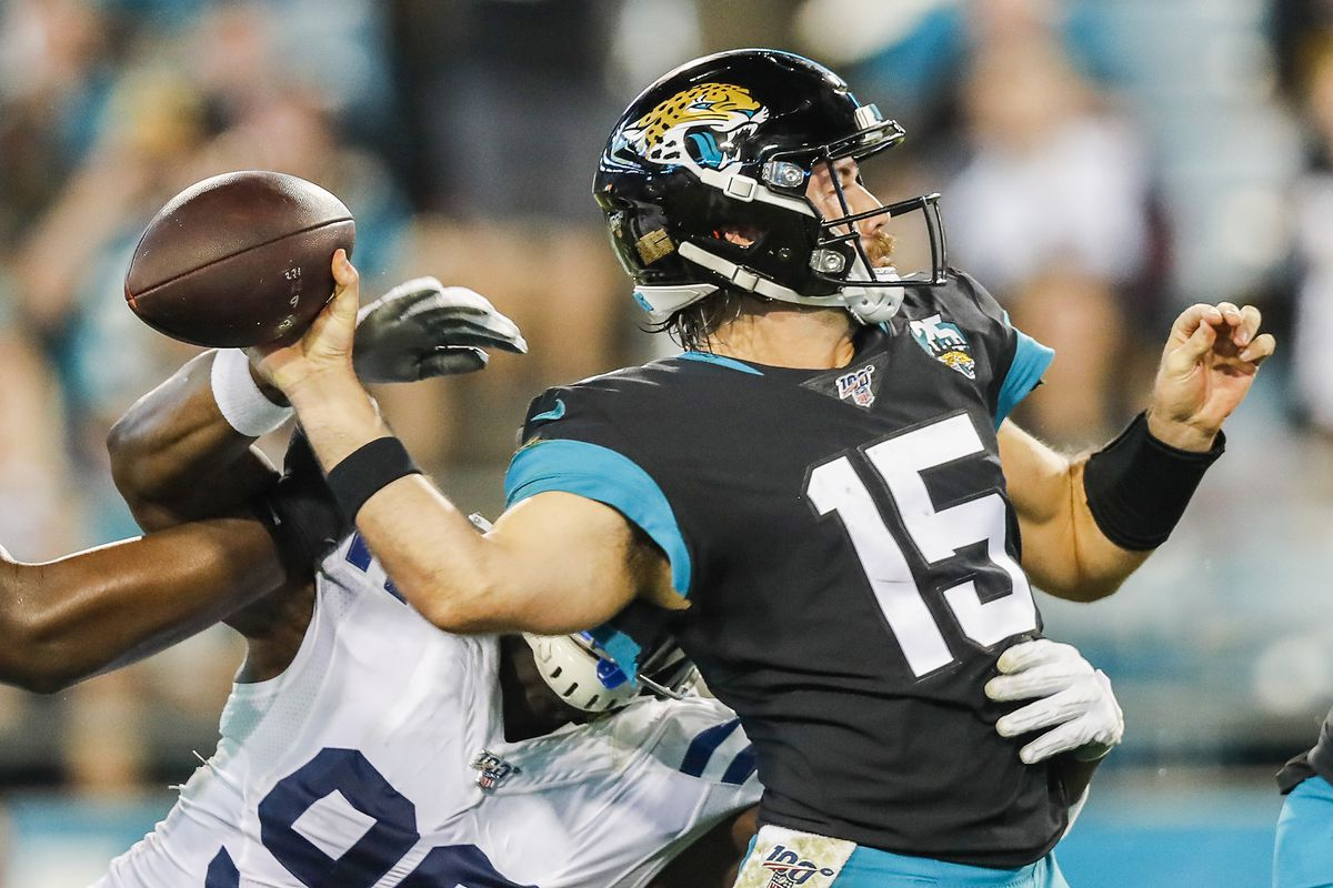 Justin Houston of the Indianapolis Colts forces a fumble by Gardner Minshew II of the Jacksonville Jaguars during the third quarter of a game at TIAA Bank Field on December 29, 2019 in Jacksonville, Florida.