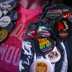 """Genevra Prothero sports buttons on her jean jacket during the """"Come Together and Fight Back"""" tour featuring Vermont Sen. Bernie Sanders and Democratic National Committee Chairman Tom Perez at the Rail Event Center in Salt Lake City on Friday, April 21, 2017. About 3,000 people attended the event."""