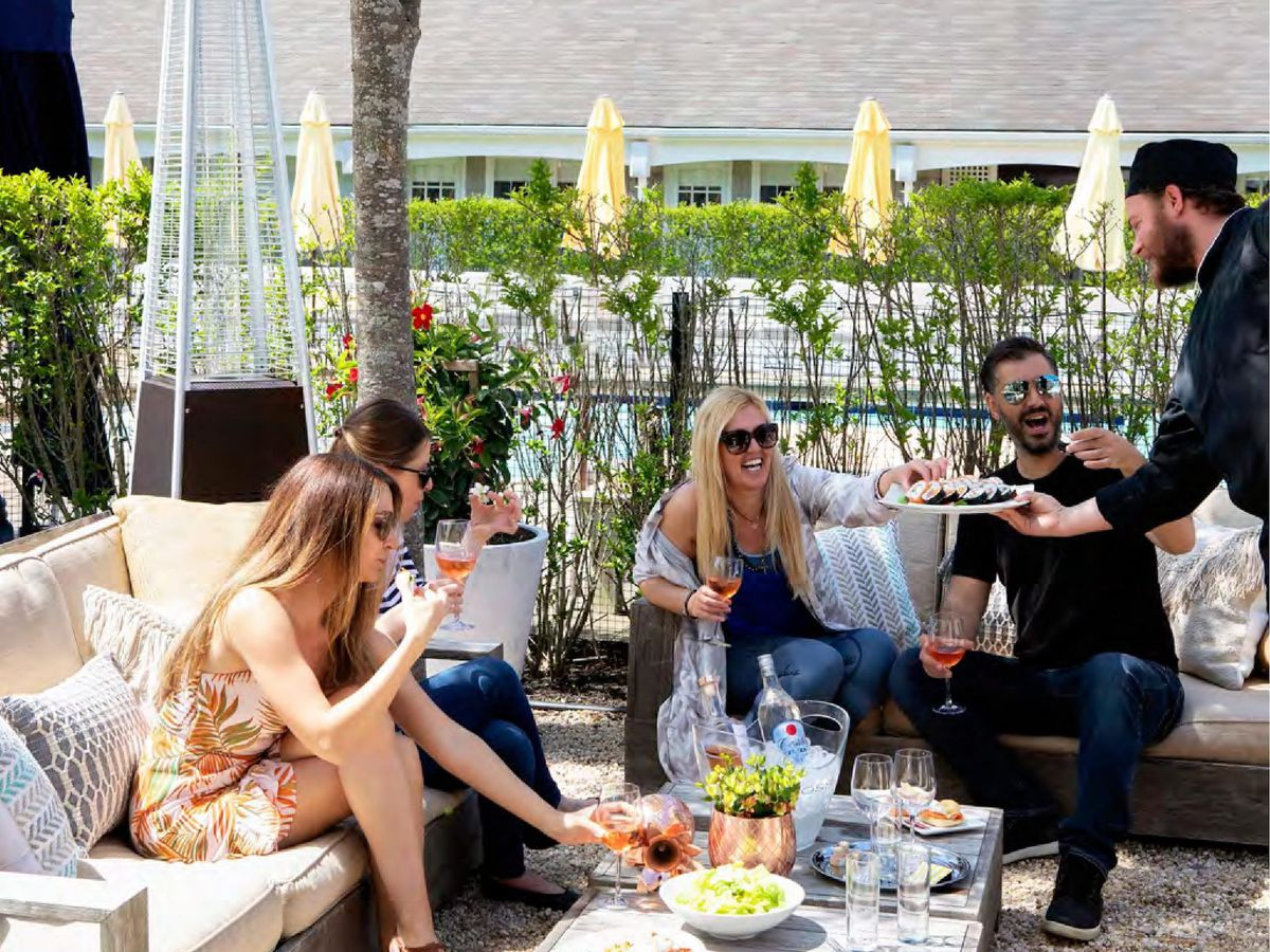 Customers dining outside in the Hamptons