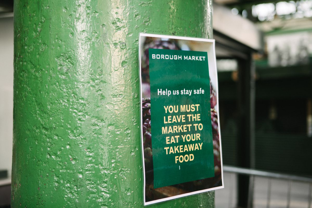 A flyer at Borough Market explaining that food purchased in one of the stalls can only be eaten outside the market