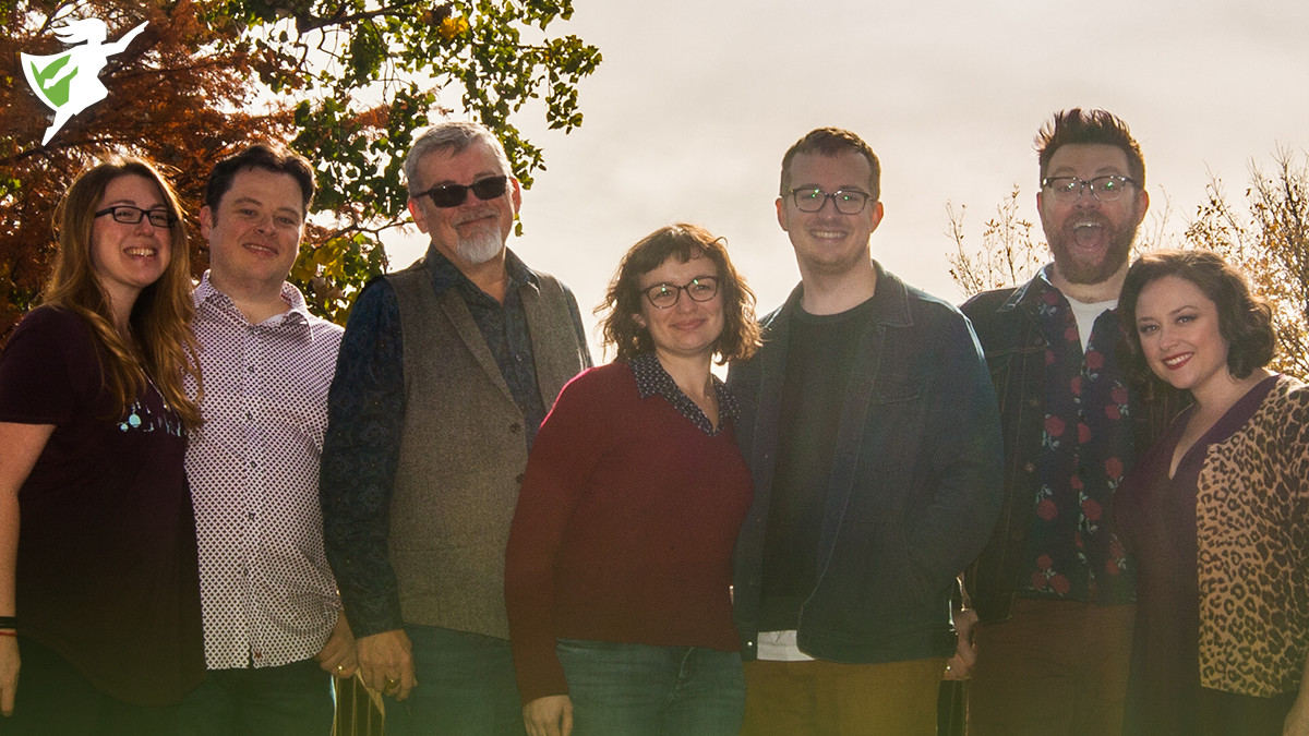 """A photo of the McElroy family, left to right Sydnee, Justin, Clint, Rachel, Griffin, Travis, and Teresa. At the bottom of the photo text reads """"THE MCELROY FAMILY Appearing All 4 Days"""". The ECCC logo is in the top left corner."""