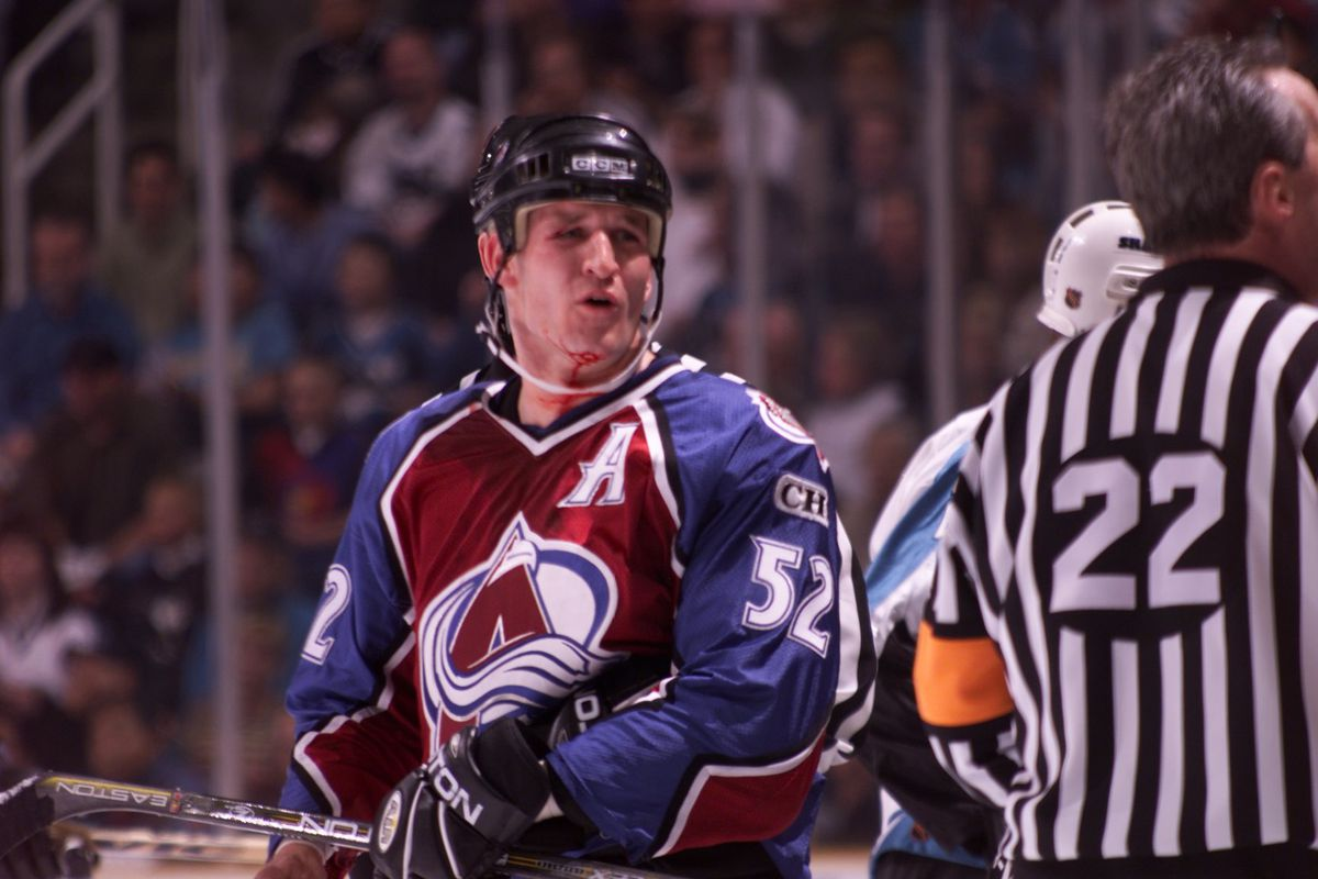 SHARKS VS AVALANCHE GAME #6 — SECOND PERIOD ACTION. COLORADO AVALANCHE DEFENSEMAN ADAM FOOTE (CQ'D), 352, JAWS WITH A SHARKS PLAYER OUT OF VIEW AFTER GETTING HIS CHIN SPLIT OPEN DURING INTENSE SECOND PERIOD ACTION, JUST BEFORE FOOTE'S TEAMMATE, THEORON F