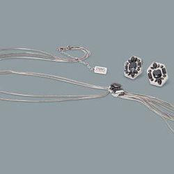 Crystal stone earrings in silver, $12.99; crystal stone tassel necklace in silver, $24.99
