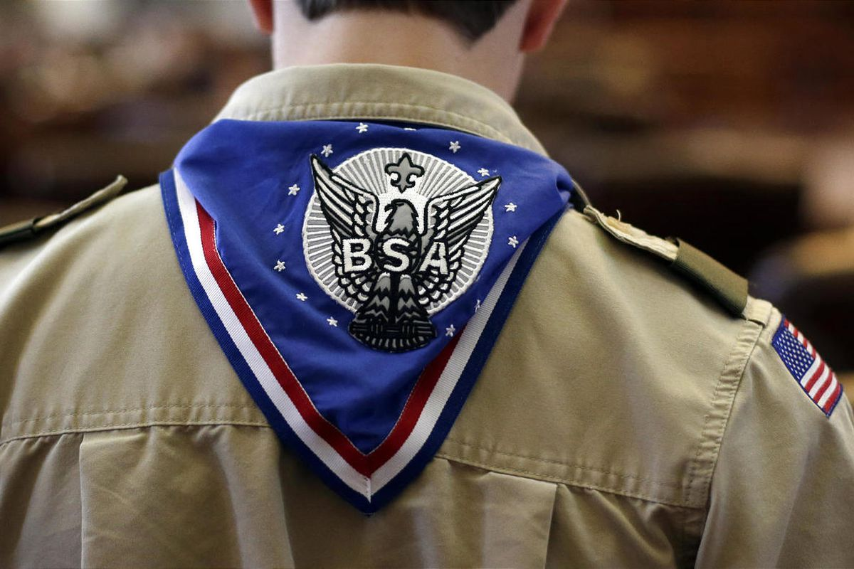 A Boy Scout wears an Eagle Scot neckerchief during the annual Boy Scouts Parade and Report to State in the House Chambers at the Texas State Capitol, Saturday, Feb. 2, 2013, in Austin, Texas. Perry says he hopes the Boy Scouts of America doesn't move soft