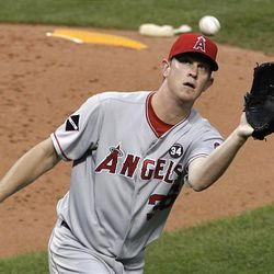 Los Angeles Angels starting pitcher Jered Weaver catches a bunt hit by Cleveland Indians' Asdrubal Cabrera in the fourth inning during a baseball game, Wednesday, Aug. 19, 2009, in Cleveland. Cabrera was out. (AP Photo/Tony Dejak)