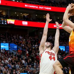 Utah Jazz forward Bojan Bogdanovic (44) aims for the basket while Portland Trail Blazers forward Mario Hezonja (44) attempts to block him during the second quarter of an NBA basketball game Vivint Arena in Salt Lake City on Friday, Feb. 7, 2020.