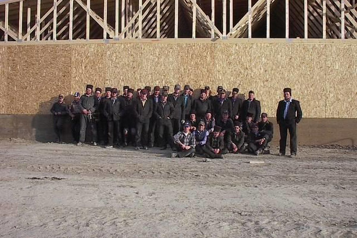 Construction workers from the Hutterite Big Sky Colony in northwestern Montana. The colony contends a Montana law forcing it to purchase workers' compensation insurance violates its religious beliefs. The Hutterites have asked the U.S. Supreme Court to he