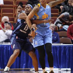 Atlanta Dream's Tiffany Hayes (15) guards Chicago Sky's Tamera Young (1).