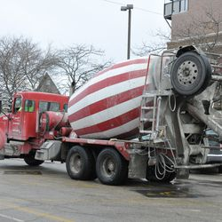 Concrete truck waiting in the blue lot next to the firehouse