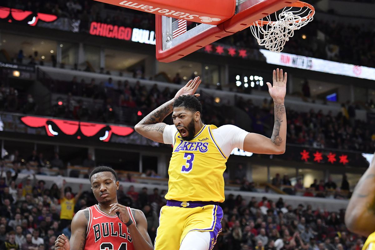 Los Angeles Lakers forward Anthony Davis reacts after his dunks in the second half against Chicago Bulls center Wendell Carter Jr. at United Center.