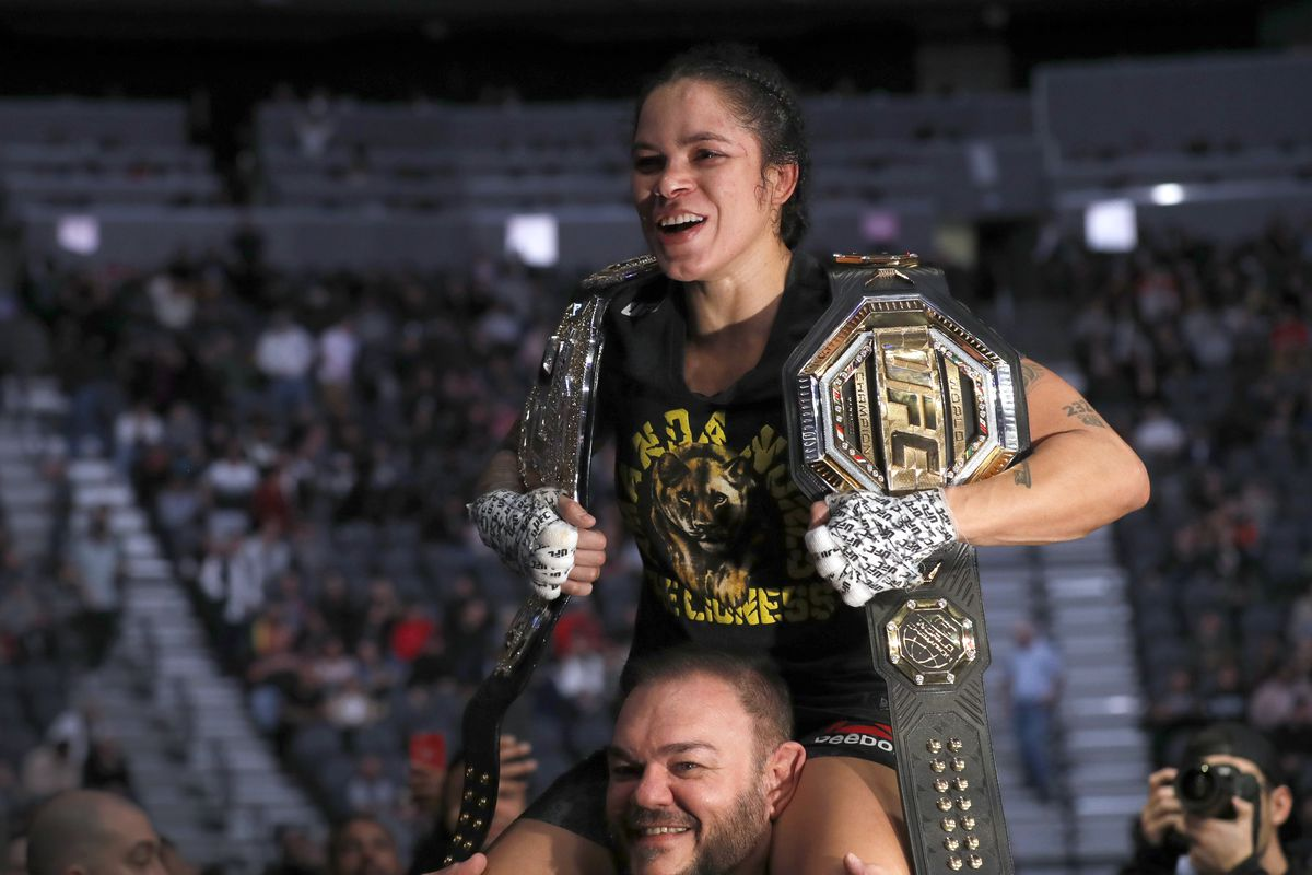 UFC women's bantamweight champion Amanda Nunes is carried from the Octagon after her unanimous-decision win over Germaine de Ranamie during UFC 245 at T-Mobile Arena on December 14, 2019 in Las Vegas, Nevada.