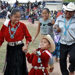 Tribe members sing and dance during the 2011 Navajo Nation Fair in Window Rock, Ariz.