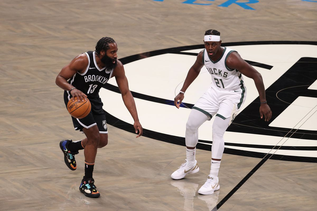 James Harden of the Brooklyn Nets in action against Jrue Holiday of the Milwaukee Bucks during their game at Barclays Center on January 18, 2021 in New York City.