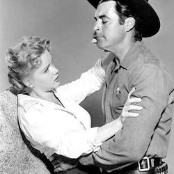 """Anne Francis is suspected of murder and Rory Calhoun is the bounty hunter hired to bring her to justice in """"The Hired Gun"""" (1957), making its DVD debut this week."""