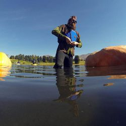 Dan Farr gets geared up to race a pumpkin as part of the 2013 Mountain Valley Seed Co. Ginormous Pumpkin Regatta at Sugarhouse Park on Saturday, October 19, 2013.