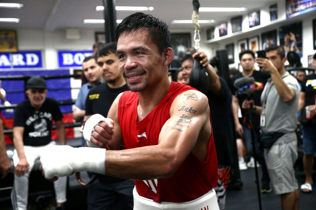 1159701586.jpg.0 - Pacquiao training after announcing plans to fight McGregor
