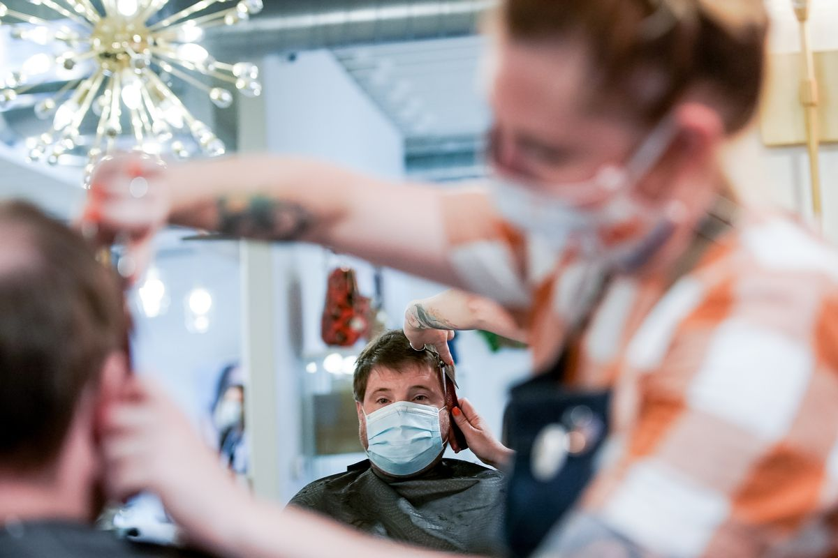 Stylist Michelle Knodel gives her brother Dan Knodel a haircut at Nailed! in Millcreek on Thursday, May 14, 2020.