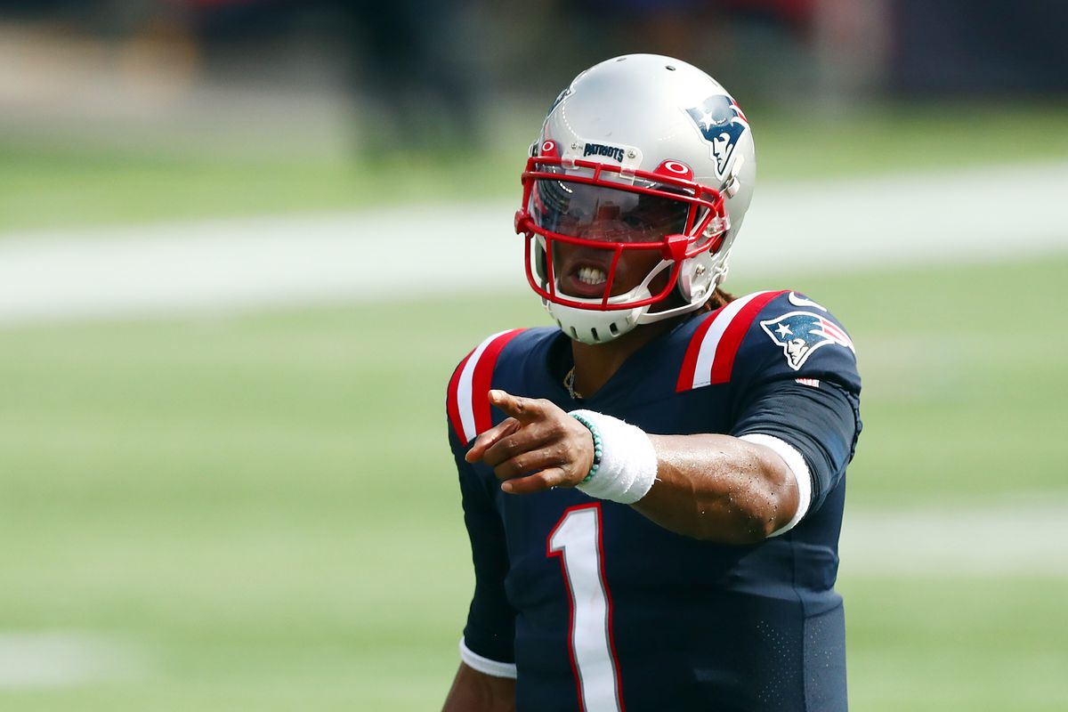 Cam Newton of the New England Patriots gestures during the first half against the Las Vegas Raiders at Gillette Stadium on September 27, 2020 in Foxborough, Massachusetts.