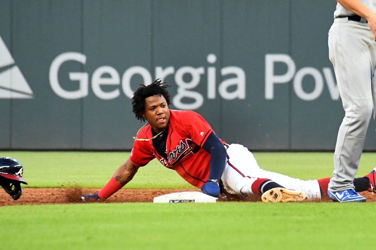 Ronald Acuna Jr. #13 of the Atlanta Braves steals second base during the second inning against the Los Angeles Dodgers at SunTrust Park on August 16, 2019 in Atlanta, Georgia.