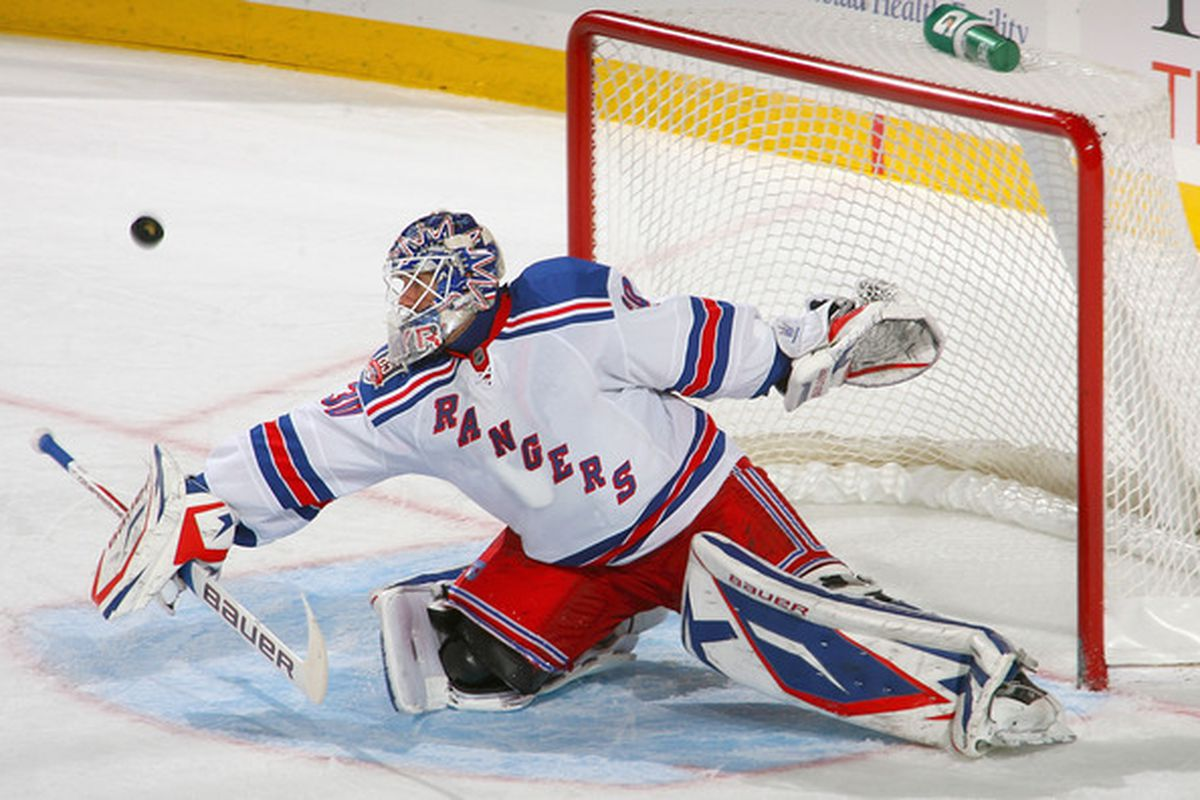 BUFFALO, NY - OCTOBER 09: Henrik Lundqvist #30 of the New York Rangers makes a save against the Buffalo Sabres  at HSBC Arena on October 9, 2010 in Buffalo, New York. New York won 6-3. (Photo by Rick Stewart/Getty Images)