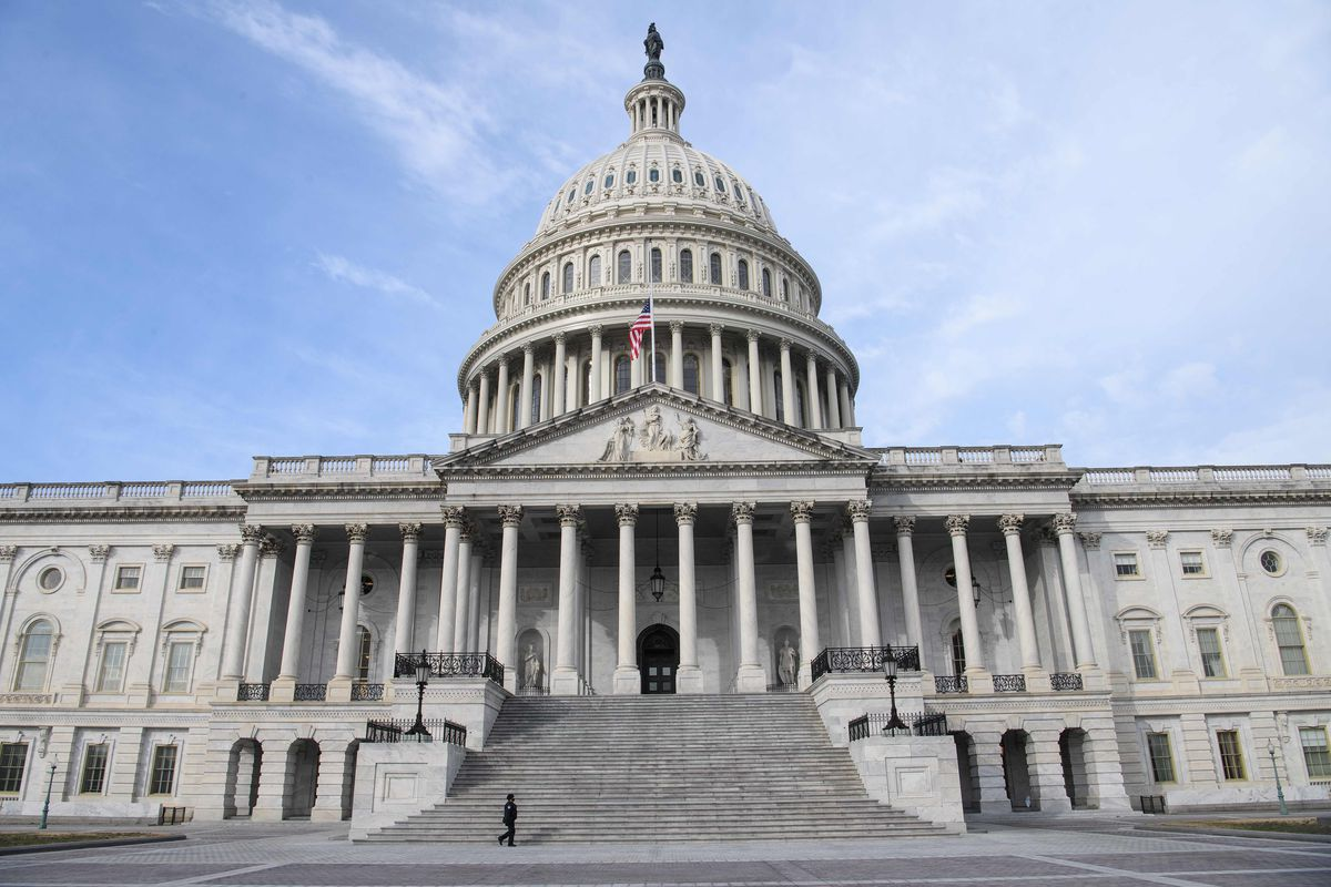 A member of the Capitol police walks past the US Capitol in Washington, DC, on February 9, 2021 before the start of former US president Donald Trump's second Senate impeachment trial.