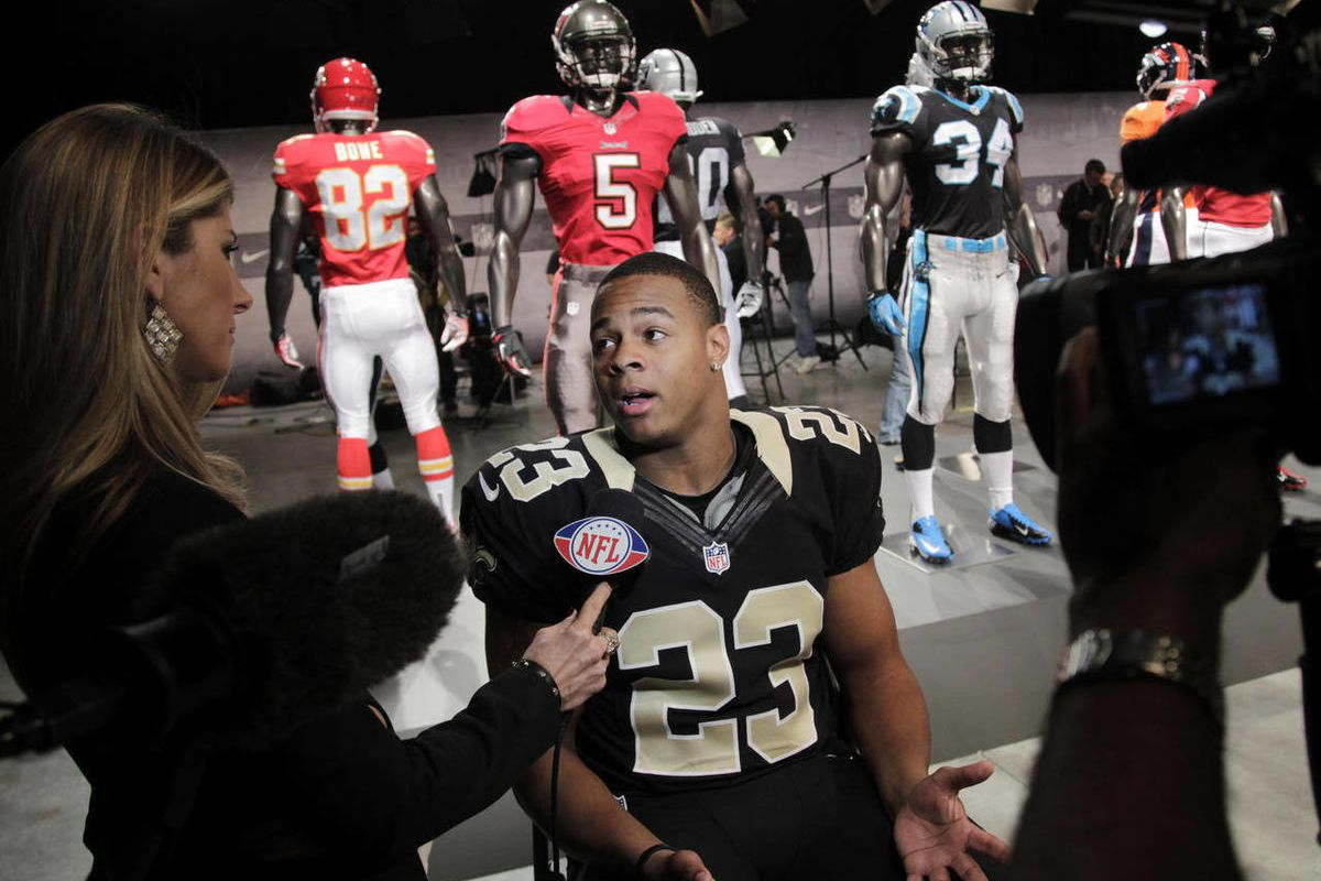 New Orleans Saints' Pierre Thomas talks to a reporter at a presentation in New York, Tuesday, April 3, 2012. The NFL  and Nike showed off the new gear in grand style with a gridiron-themed fashion show at a Brooklyn film studio.