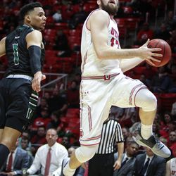 Utah Utes forward David Collette (13) goes in for a basket past Hawaii Warriors guard Drew Buggs (1) as Utah hosts Hawaii at the Huntsman Center in Salt Lake on Saturday, Dec. 2, 2017.