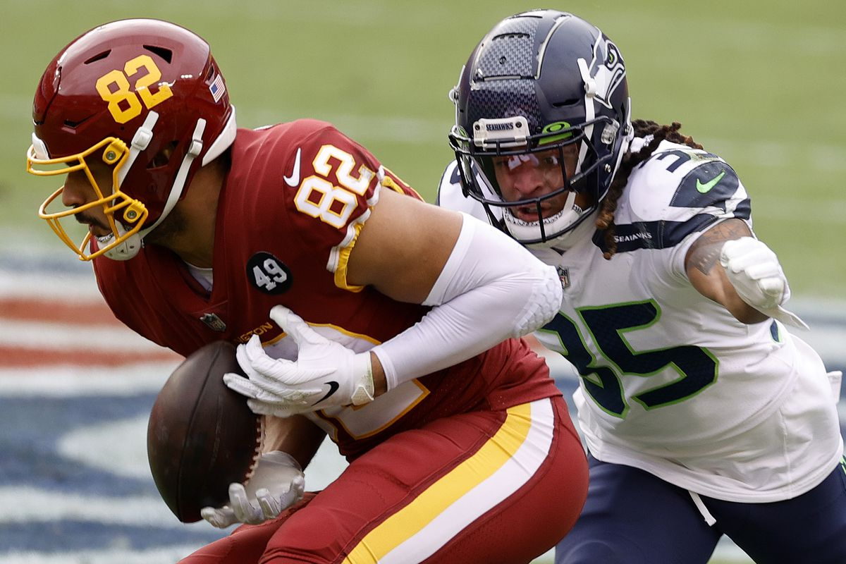 Logan Thomas #82 of the Washington Football Team makes a reception against the Seattle Seahawks at FedExField on December 20, 2020 in Landover, Maryland.