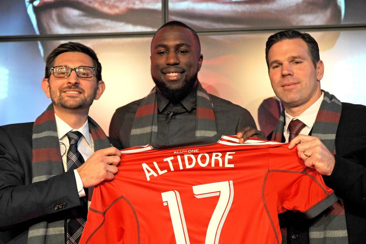 Jozy holding up a jersey he won't wind up wearing