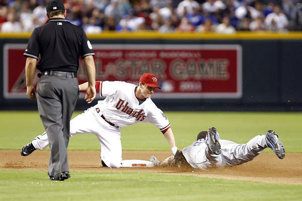 Los Angeles Dodgers Matt Kemp is caught stealing second by Arizona Diamondbacks shortstop Stephen Drew.