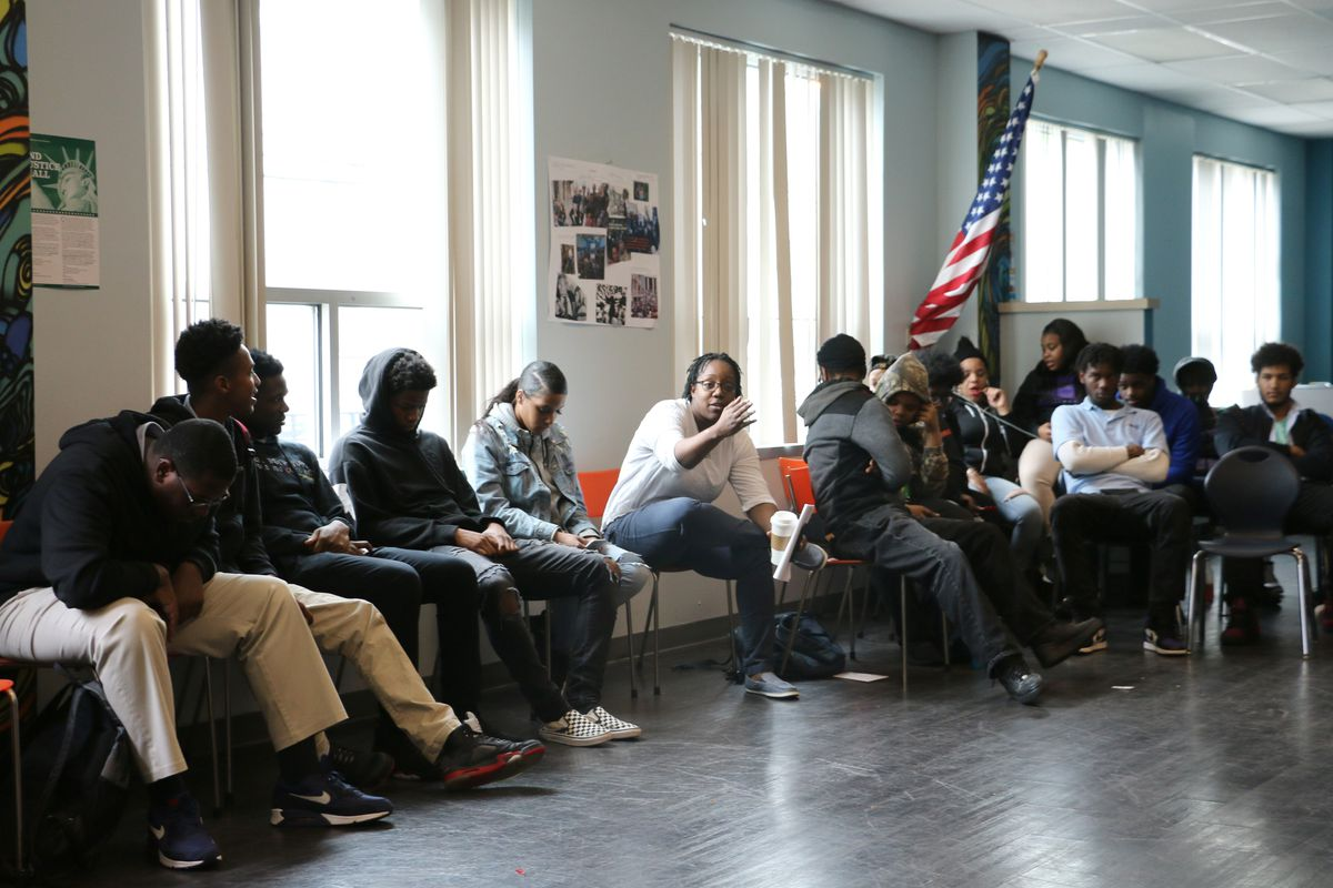 """Gisele Bartley (center) is one of LEAD's """"advocate-counselors,"""" who enmesh themselves in students' lives."""