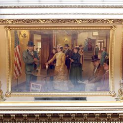 """The painting entitled """"Sarah Young Votes"""" hangs in the House chamber at the Utah State Capitol in Salt Lake City on December 21, 2007. Young was the first woman in the United States to vote in 1869."""